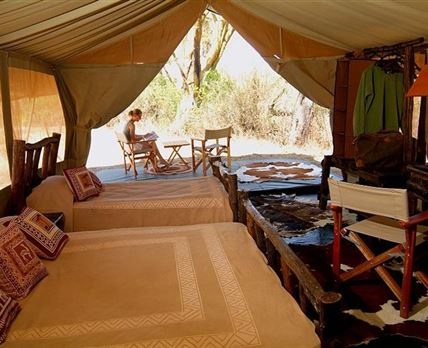 Relaxing at Porini Mara Camp © Gamewatchers Safaris Ltd