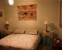 Main Bedroom with queen-size bed and built-in cupboards.