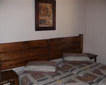 Two single beds, bathroom with bath.