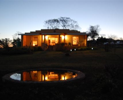 View of the guest house from the Lilly pond.