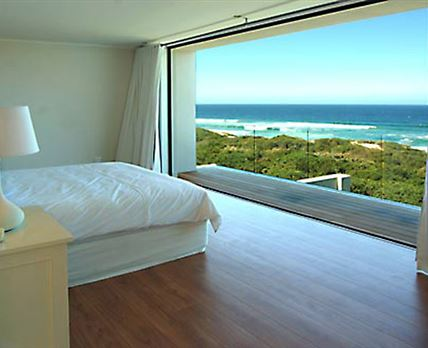 The Master Bedroom Suite looks out over the ocean