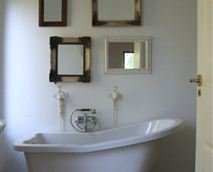 each unit has a down-stairs bathroom with shower and victorian bath <br />