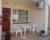 Rooms front with garden chairs for out door