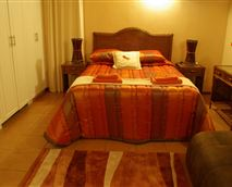 En-suite room with double bed and sleeper couch.