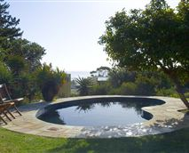 Solar heated swimming pool set in the large indigenous garden. © Charles Didcott