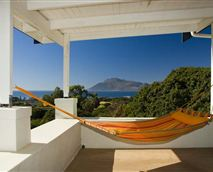 Relax in the hammock while you watch the surf. © Charles Didcott