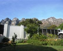 Walled property with mountain views