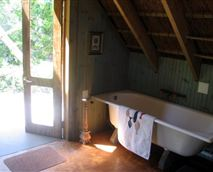 in the thatched treehouse, Driftwood Cottage