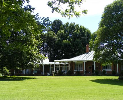 The 100-year old main farmhouse where sumptuous breakfasts are served.