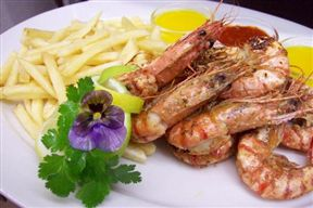 8 suculent prawns served with lemon butter, garlic butter and peri-peri sauce with your choice of chips, rice or salad