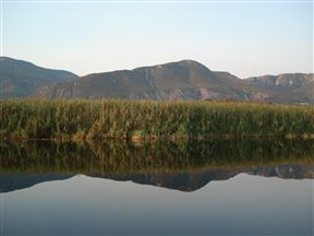 Magnificent views of the mountains, from the tranquil stillness of the river.
