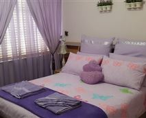 Main bedroom with Tv and Airconditioner. Clock Radio.
