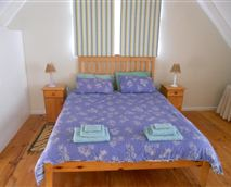 Room with king-size bed and double bunk.