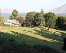 Hillside Lodge with Bulwer Mountain in the background
