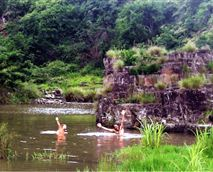 Enjoy a day in the sun at the Mdumbi Sacred Pools.