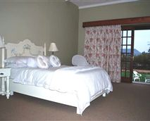 A spacious room with a double bed.