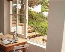 Enjoy a peaceful breakfast while looking out onto the garden.