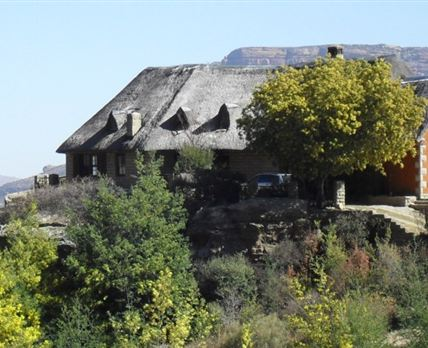 Built on a rocky outcrop overlooking the village.