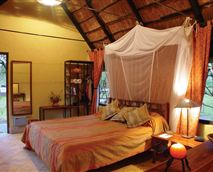 All our rustic, thatched chalets have creative mukwa and wrought iron fittings, en-suite tiled bathrooms, mosquito proofing with treated nets, ceiling fans, internal safe, and views over the Maramba river or floodlit waterhole.Our chalets are available in twins, doubles and family units that sleep 4.