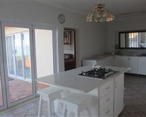 Our open plan kitchen has folding doors leading onto the deck for easy entertaining