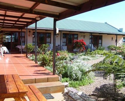 Main House - 4 Sleepers, Flats & Single Rooms all opening onto verandah.