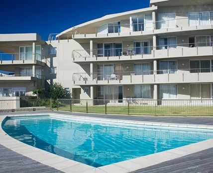 This ground floor swimming pool is a few metres walk from your apartment, and is adjacent to the beach.