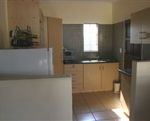 Fridge and ample cupboard space.  Fully kitted kitchenette.