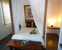 Bedroom © Brigitte Robert-Parker Villa Ayr Inc