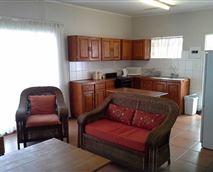 Flat lounge and kitchen