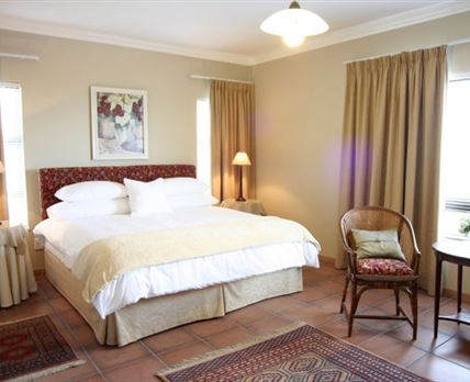 Spacious room with king-size bed. © False Bay View