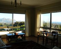 Showing gorgeous panoramic ocean and mountain views. © False Bay View