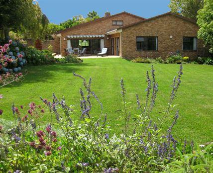 sliding doors and patio onto private garden