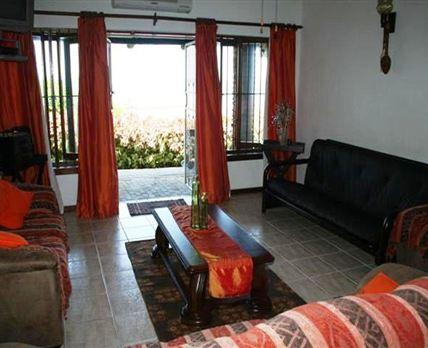 Lounge leading onto veranda