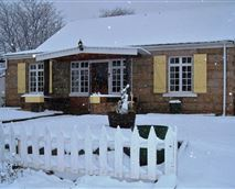 View of a snowy Lemon Tree Lodge