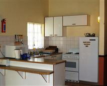 View of a fully equipped kitchen.