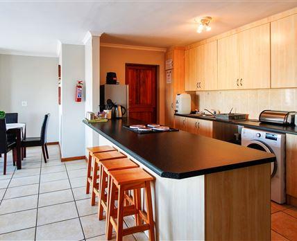 Open plan kitchen/living area with indoor braai