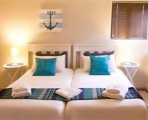 Guest room with 2 single beds, shower, bar fridge, microwave, bar fridge, DSTV