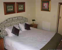 Comfortable king-sized bed with extra single bed