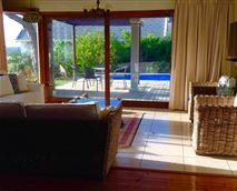 Manor sitting room, deck and pool