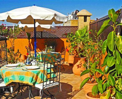 Enjoy breakfast on our sunny roof terrace.