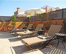 Relax on our sunny roof terrace with a good book.