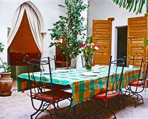 Enjoy breakfast or dinner in the light, plant-filled courtyard garden.