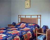 THE BLUE ROOM IN DUNFORDS LOFT HAS DOUBLE BED, SINGLE BED, COT AND MAIN EN-SUITE BATHROOM