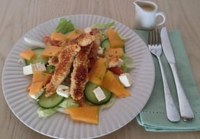 Sesame seed chicken and melon salad with honey mustard dressing