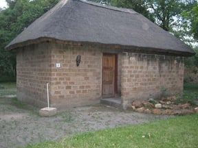 Thatched roof with bricks made by ourselves
