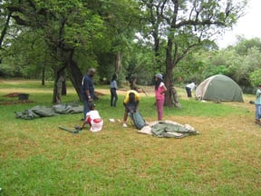 The campsite is laid to lawn with indigenous trees amongst the lawn. Brick surrounded sand pits availabel for campfires