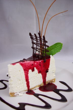 a fridge Cheesecake doused with a wild Berry Coulis