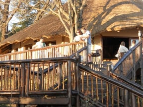 The entrance to the thatched restaurant overlooking the waterfall.