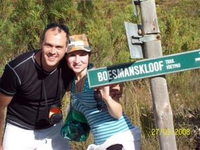 The Boesmanskloof Trail winds through the only gap in the rugged Riviersonderend mountain range. It is in the Robertson Karoo region of the south-western Cape. The trail links the small towns of Mcgregor in the north to Greyton in the south. It has become on of the most popular trails in the Western Cape, especially as the beautiful colonial-style town of Greyton lies at the one end.   The length of the trail is approximately 15,8 km and may be hiked within one day. It can be started from either Mcgregor or Greyton. While the trail lies just outside Greyton, it only commences 14 km to the south of Mcgregor at Die Galg. Hikers may often choose to walk the trail there and back (a total of 28 Km ) and overnight in either of the two towns. Another delightful option is to begin the trail at Mcgregor and walk to Greyton, stay the night at the Post House Tel. (02822 9995) and return to Mcgregor the following day. Useful Information This is winter rainfall area (generally cold and wet) and the summer months are extremely warm and dry. Water may be required during the summer months. Physically the trail requires a reasonable degree of fitness as it continuously ascends, descends and contours the slopes of Boesmanskloof. Permits are necessary, obtainable from the Sonderend State Forest in Robertson. No overnight camping is allowed on the trail. There is however, a municipal campsite in Greyton. Because the trail requires between 4 - 5 hours to complete, there is plenty of time for swimming and enjoying the views. How to get there?  See directions from Cape Town to Greyton. Alternatively from Cape Town follow the N1 to Worcester (about 100 km), turn from the N1 to Robertson (about 55 km) and from there to Mccregor (about 25 km) Main Attractions The main attractions along the route are the spectacular mountain scenery; large rock pools waterfalls and Lovely Cape wildflowers. Highlights include views of the majestic Riviersonderend Mountains, with their steep gorges and the lush